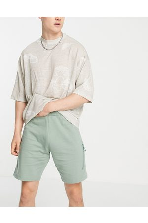 ASOS Co-ord jersey shorts with utility seams in green