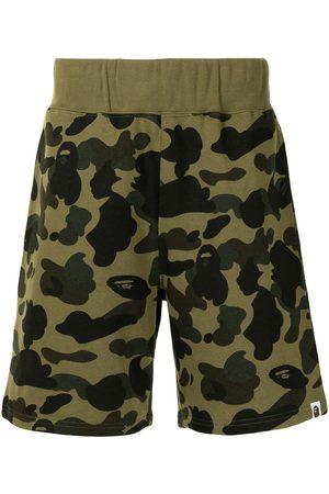 A Bathing Ape Herren Kurze Hosen - Camouflage-print cotton track shorts