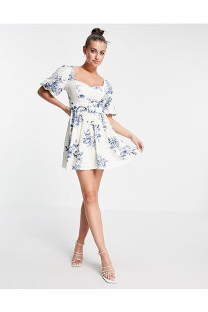 ASOS DESIGN Broderie puff sleeve corset belted skater mini dress in floral print-Multi