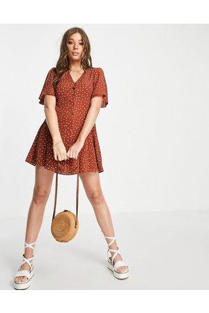 ASOS DESIGN Button through tie back mini tea dress with angel sleeve in rust spot print-Multi