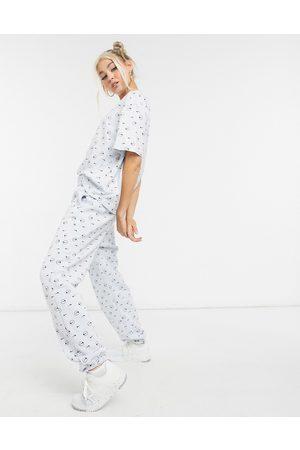 Nike Damen Jogginghosen - Joggers in grey all over logo print-Multi