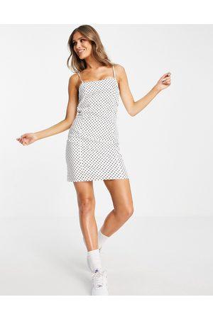 NA-KD Spot print cami mini dress in white