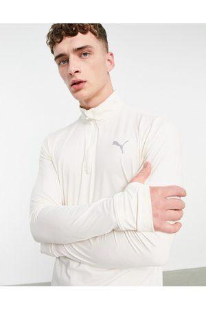 Puma Running Favourite quarter zip sweatshirt in cream-White