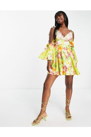 Lashes of London Fluted sleeve strappy back mini dress in tropical floral print-Multi
