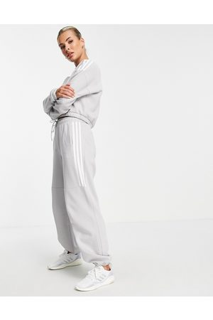 adidas Adidas Training oversized joggers with three stripes in grey