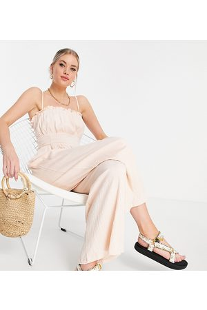 ASOS Tall ASOS DESIGN tall cami frill edge textured jumpsuit in pale pink