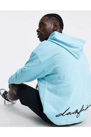 ASOS Dark Future Oversized hoodie with quarter zip and multi logo embroidery in blue