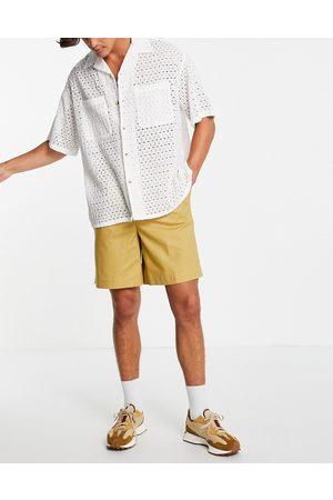 ASOS DESIGN Herren Shorts - High waist slim shorts in mustard linen-Yellow