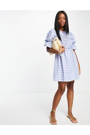 River Island Damen Kleider - Checked shirred mini dress in blue