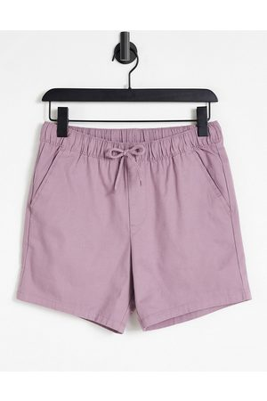 ASOS DESIGN Skinny chino shorts with elasticated waist in purple