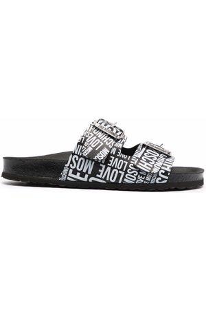Love Moschino Damen Jumpsuits - All-over logo-print sandals