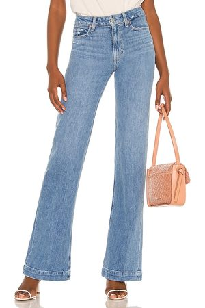 Paige Leenah Flare Jean in - Blue. Size 23 (also in 24, 25, 26, 27, 28, 29, 30).