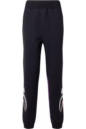 A BATHING APE® Color Camo Side Shark track pants
