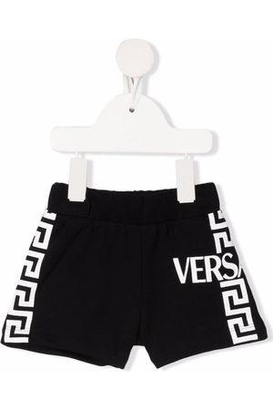 VERSACE Greca-print track shorts