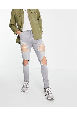 ASOS Spray on jeans with power stretch in grey with heavy rips