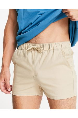 ASOS DESIGN Chino shorter shorts in slim fit with elasticated waist in -Neutral
