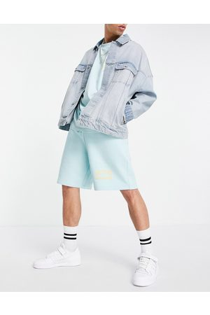 ASOS Actual Athlesiure co-ord relaxed short with logo print in canal blue