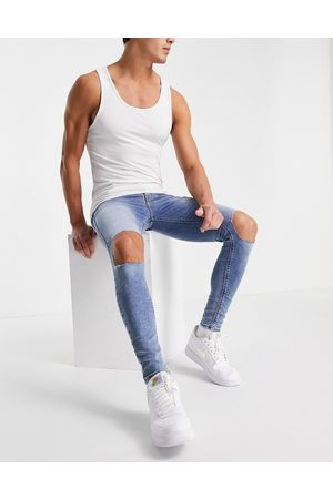 ASOS Spray on jeans with powerstretch in mid wash blue with knee rips