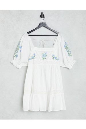 ASOS DESIGN Lace insert mini smock dress with floral embroidery in white
