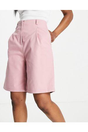 Ghospell Longline bermuda shorts in powdered pink co-ord