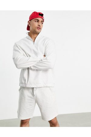 ASOS Tracksuit with oversized half zip sweatshirt and oversized short in white marl