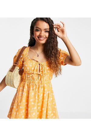 ASOS ASOS DESIGN petite seersucker tie front tiered beach mini dress in two tone floral print-Multi