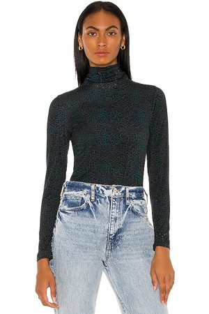 Camilla Jersey Turtleneck in - Green. Size L (also in XS, S, M).