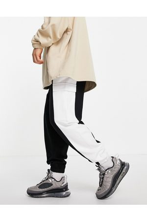 ASOS Oversized cargo joggers in black and white colour block-Navy