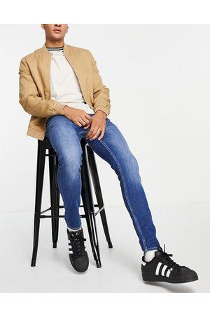 New Look Herren Skinny - Super skinny jeans in washed mid blue
