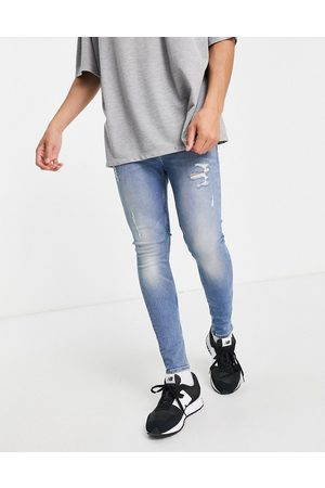 ASOS Organic cotton blend spray on jeans with powerstretch in vintage light wash with abrasions-Blue