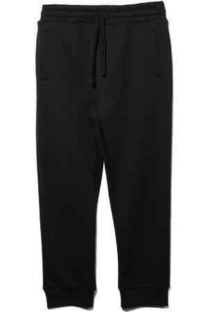 Dolce & Gabbana Jungen Hosen & Jeans - DG BOY TRK PNT W GTHRD ANKL WSTBD