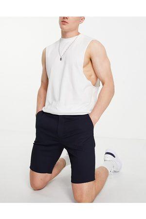 ASOS DESIGN Slim mid length smart shorts in navy