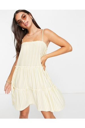 ASOS Strappy sundress with tiered frill detail in buttermilk stripe-Yellow