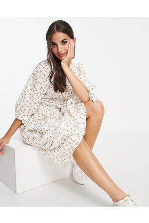 ASOS Shirred bodice midi smock dress with tie sleeves in white based floral print-Multi