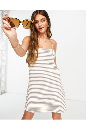 ASOS Mini sundress with cut out detail in towelling in cream stripe-White