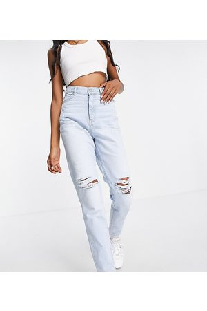 Dr Denim Nora high rise mom jeans with ripped knees in bleach wash blue