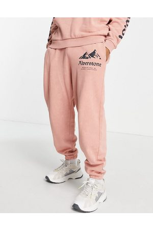 ASOS Herren Lange Hosen - Co-ord balloon joggers in washed pink with mountain print