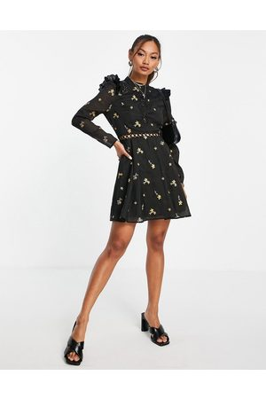 ASOS High neck all over embroidered skater mini dress with lace inserts in black