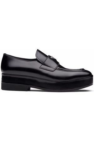 Prada Logo-plaque square-toe loafers