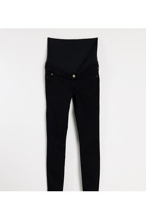 River Island Maternity Molly overbump skinny jeans in black