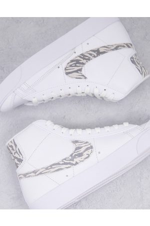 Nike Blazer Mid 77 trainers in white and zebra print