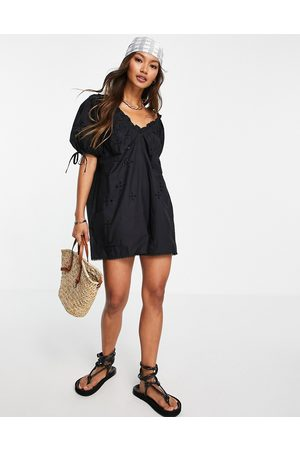 River Island Textured puff sleeve playsuit in black