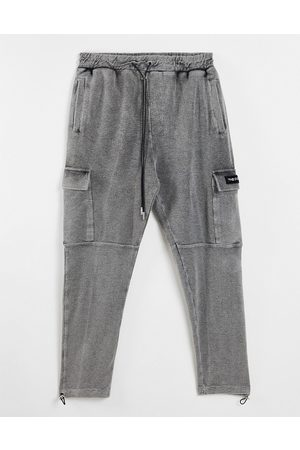 The Couture Club Reverse loopback cargo trousers in black acid wash