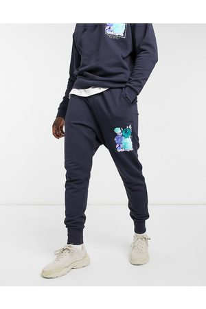 ASOS Co-ord tapered joggers in navy with flower print