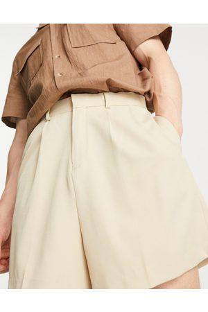 ASOS DESIGN Cropped bermuda smart shorts in black