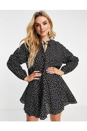 Glamorous Mini swing dress with pleated hem in black mini floral