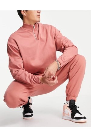 ASOS Tracksuit with oversized half zip sweatshirt and oversized joggers in pink