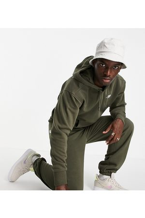 The North Face Oversized Essential joggers in khaki Exclusive at ASOS-Green