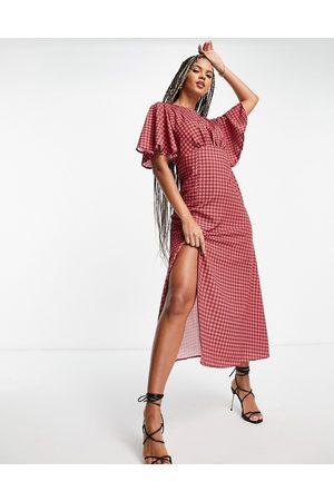 John Zack Midi tea dress with split in red gingham