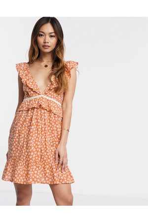 ASOS Tiered mini sundress with frill lace inserts in ditsy floral print